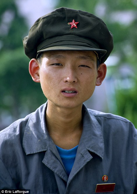 1 - This Photographer Was Banned Because He Took Some Never Seen Photos In North Korea.!!
