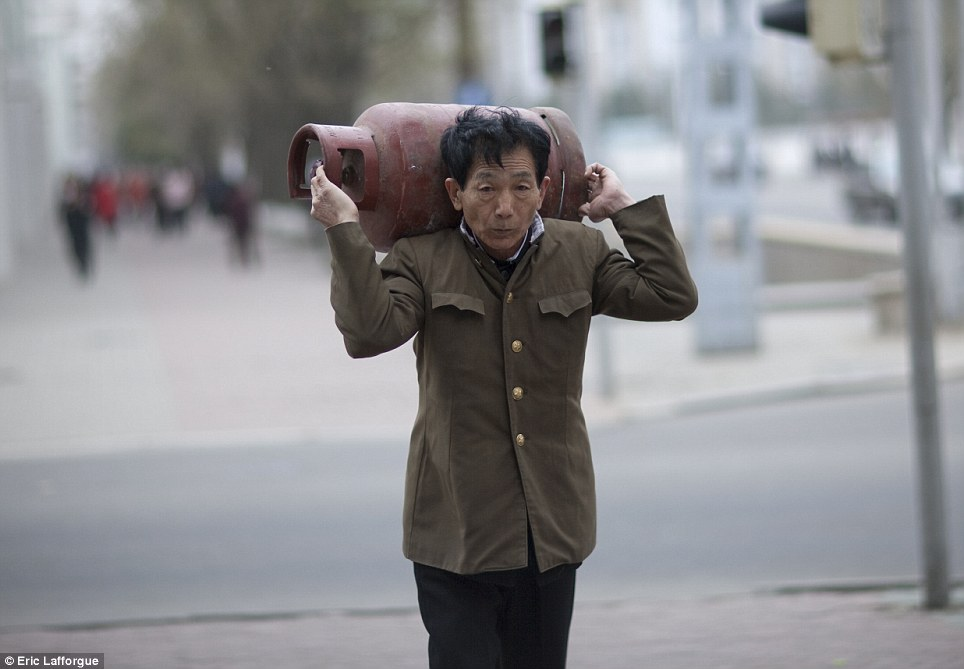 7 - This Photographer Was Banned Because He Took Some Never Seen Photos In North Korea.!!